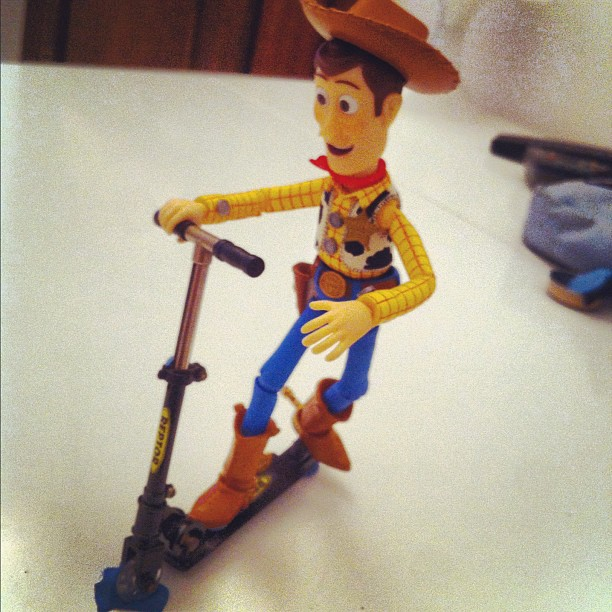 Woody is learning to ride a miniscooter!!