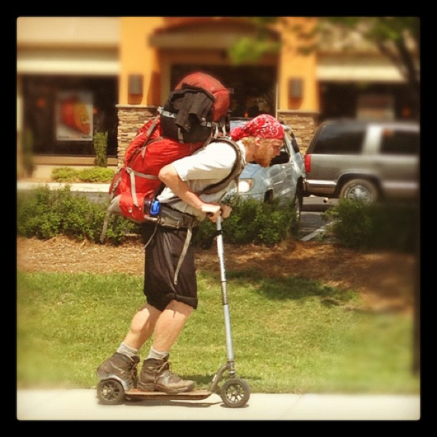 This guy knows what's up. Riding a #razorscooter in #hikingboots #backpack. Ready for #outwardbound