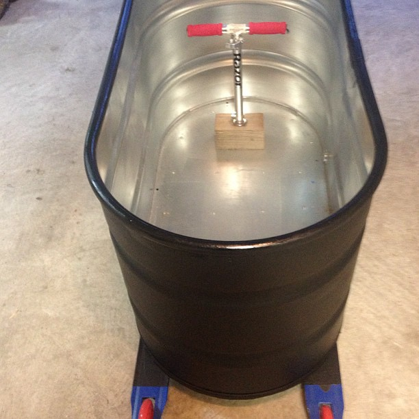 100 gallon stock tank with 125mm Razor Scooter wheels ready for Big Wheel race
