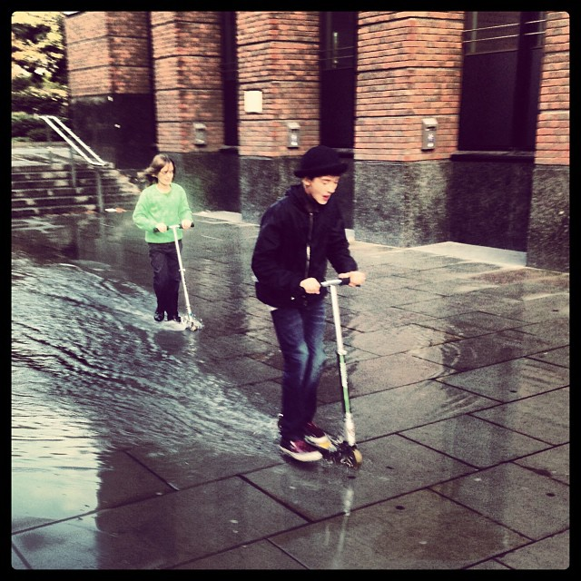 LondonSurfing #rain is #fun #kids #kickscooter #water #happiness